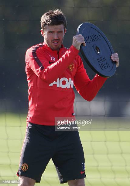Michael Carrick of Manchester United in action during a first team training session at Aon Training Complex on October 2, 2014 in Manchester, England.