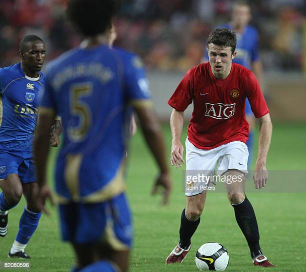 Michael Carrick of Manchester United in action during the preseason friendly match between Manchester United and Portsmouth during their preseason...