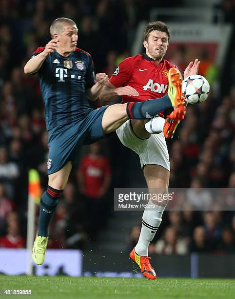 Michael Carrick of Manchester United in action with Bastian Schweinsteiger of Bayern Munich during the UEFA Champions League quarterfinal first leg...
