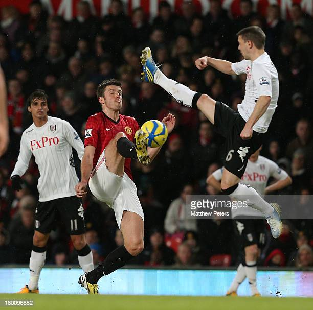 Michael Carrick of Manchester United in action with Chris Baird of Fulham during the FA Cup Fourth Round match between Manchester United and Fulham...
