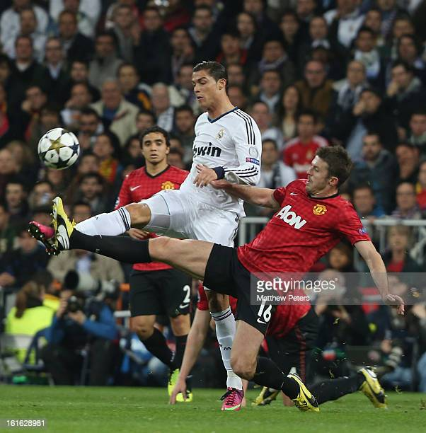 Michael Carrick of Manchester United in action with Cristiano Ronaldo of Real Madrid during the UEFA Champions League Round of 16 first leg match...