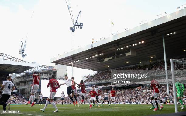 Michael Carrick of Manchester United in action with Eric Dier of Tottenham Hotspur with cranes building Tottenham's new stadium in the background...