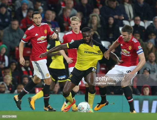 Michael Carrick of Manchester United in action with Hope Akpan of Burton Albion during the Carabao Cup Third Round between Manchester United and...