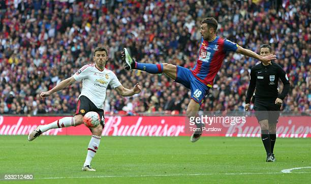 Michael Carrick of Manchester United in action with James McArthur of Crystal Palace during The Emirates FA Cup final match between Manchester United...