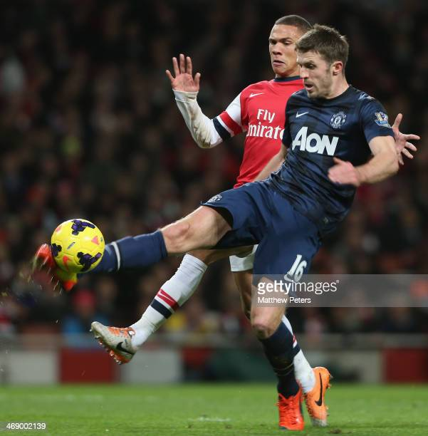 Michael Carrick of Manchester United in action with Kieran Gibbs of Arsenal during the Barclays Premier League match between Arsenal and Manchester...
