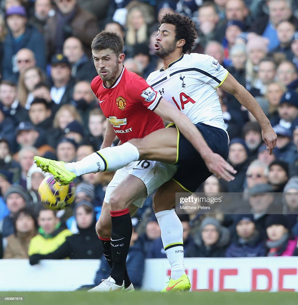 Michael Carrick of Manchester United in action with Mousa Dembele of Tottenham Hotspur during the Barclays Premier League match between Tottenham Hotspur and Manchester United at White Hart Lane on December 28, 2014 in London, England.