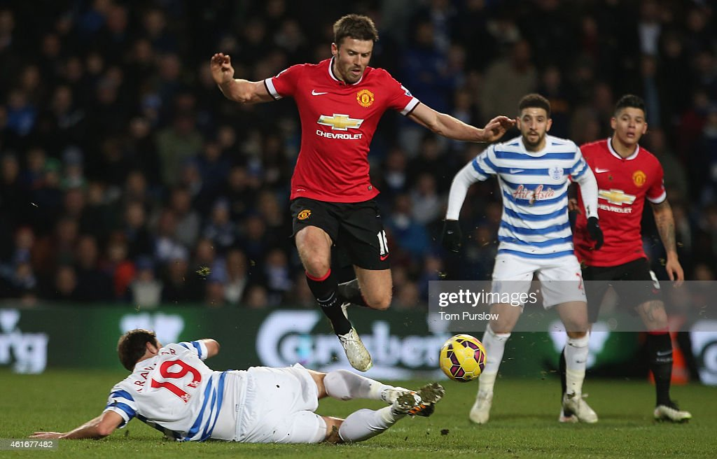 Michael Carrick of Manchester United in action with Niko Kranjcar of Queens Park Rangers during the Barclays Premier League match between Queens Park Rangers and Manchester United at Loftus Road on January 17, 2015 in London, England.