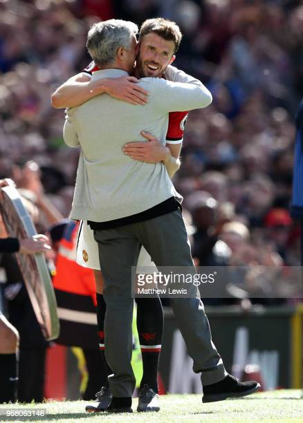 Michael Carrick of Manchester United is embraced by Jose Mourinho Manager of Manchester United after he is subsituted during the Premier League match...