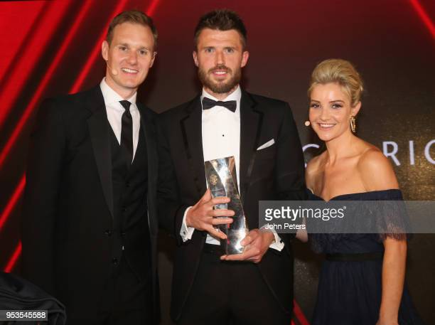 Michael Carrick of Manchester United is presented with a Special Contribution award by hosts Dan Walker and Helen Skelton at the club's annual Player...