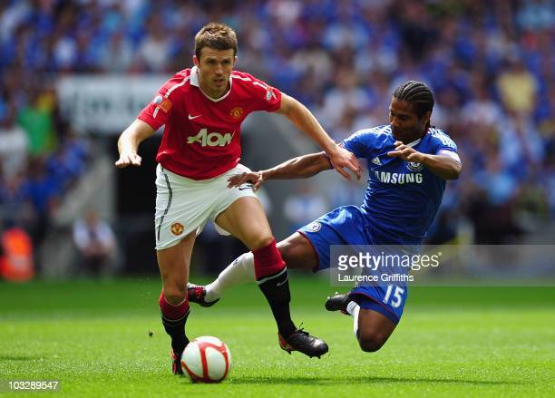 Michael Carrick of Manchester United is tackled by Florent Malouda of Chelsea during the FA Community Shield match between Chelsea and Manchester...