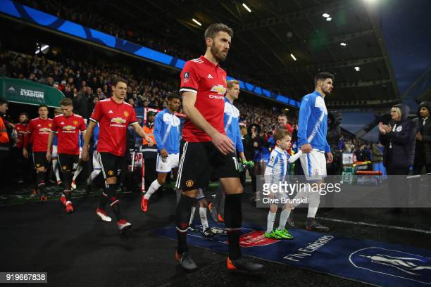 Michael Carrick of Manchester United leads his team out on to the pitch during the The Emirates FA Cup Fifth Round between Huddersfield Town v...