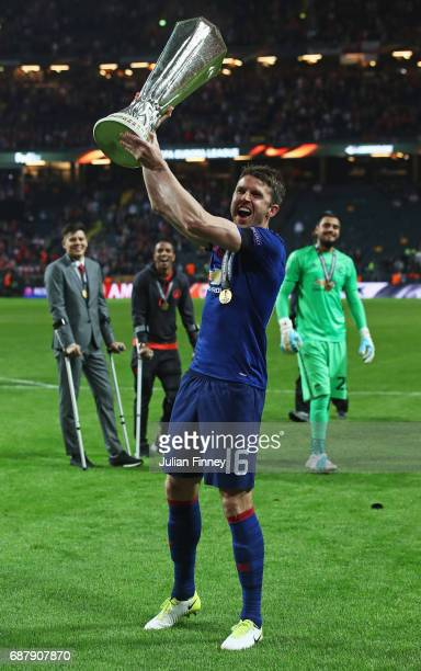 Michael Carrick of Manchester United lifts The Europa League trophy following victory in the UEFA Europa League Final between Ajax and Manchester...