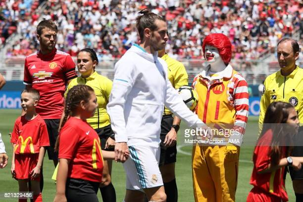 Michael Carrick of Manchester United looks on as Ronald McDonald walks out holds the match ball prior to the International Champions Cup 2017 match...