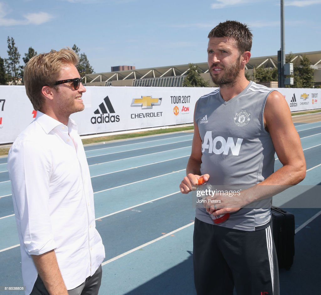 Michael Carrick of Manchester United meets Formula One world champion Nico Rosberg ahead of a first team training session as part of their pre-season tour of the USA at UCLA on July 18, 2017 in Los Angeles, California.