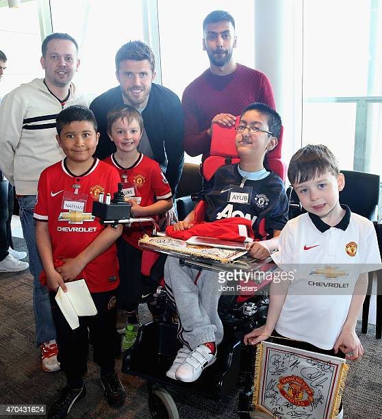 Michael Carrick of Manchester United poses with Nathan, Luke and Ayub at a Manchester United Foundation Dream Day, where sick children and adults...