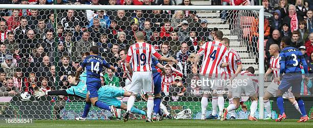 Michael Carrick of Manchester United scores their first goal during the Barclays Premier League match between Stoke City and Manchester United at...