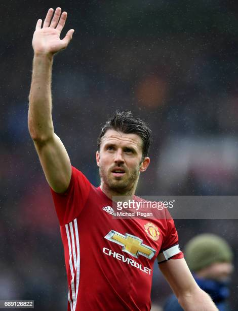 Michael Carrick of Manchester United shows appreciation to the fans after the Premier League match between Manchester United and Chelsea at Old...