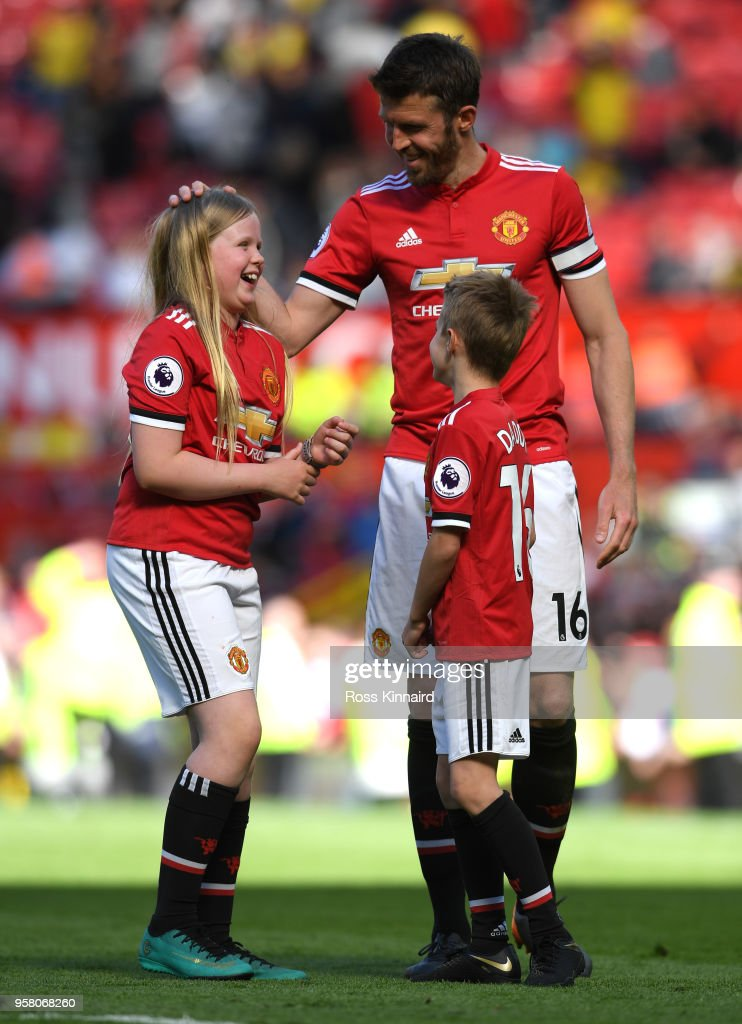 Michael Carrick of Manchester United shows appreciation to the fans during the lap of honour with his family after the Premier League match between Manchester United and Watford at Old Trafford on May 13, 2018 in Manchester, England.