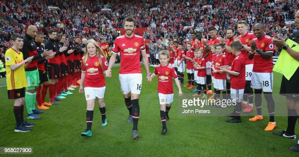 Michael Carrick of Manchester United walks out ahead of his final Premier League match for the club at the Premier League match between Manchester...
