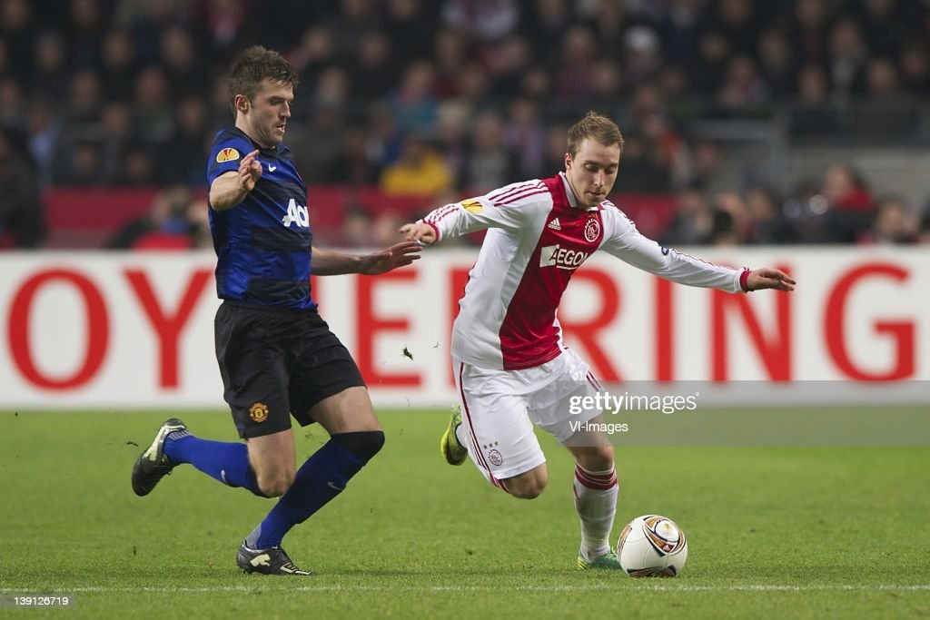 Michael Carrick of Manchester United,Christian Eriksen of Ajax during the UEFA Europa League round of 32 match between AFC Ajax and Manchester United FC at the Amsterdam Arena on February 16, 2012 in Amsterdam, Netherlands.