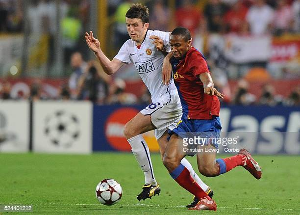 Michael Carrick of Manchester with Eric Abidal