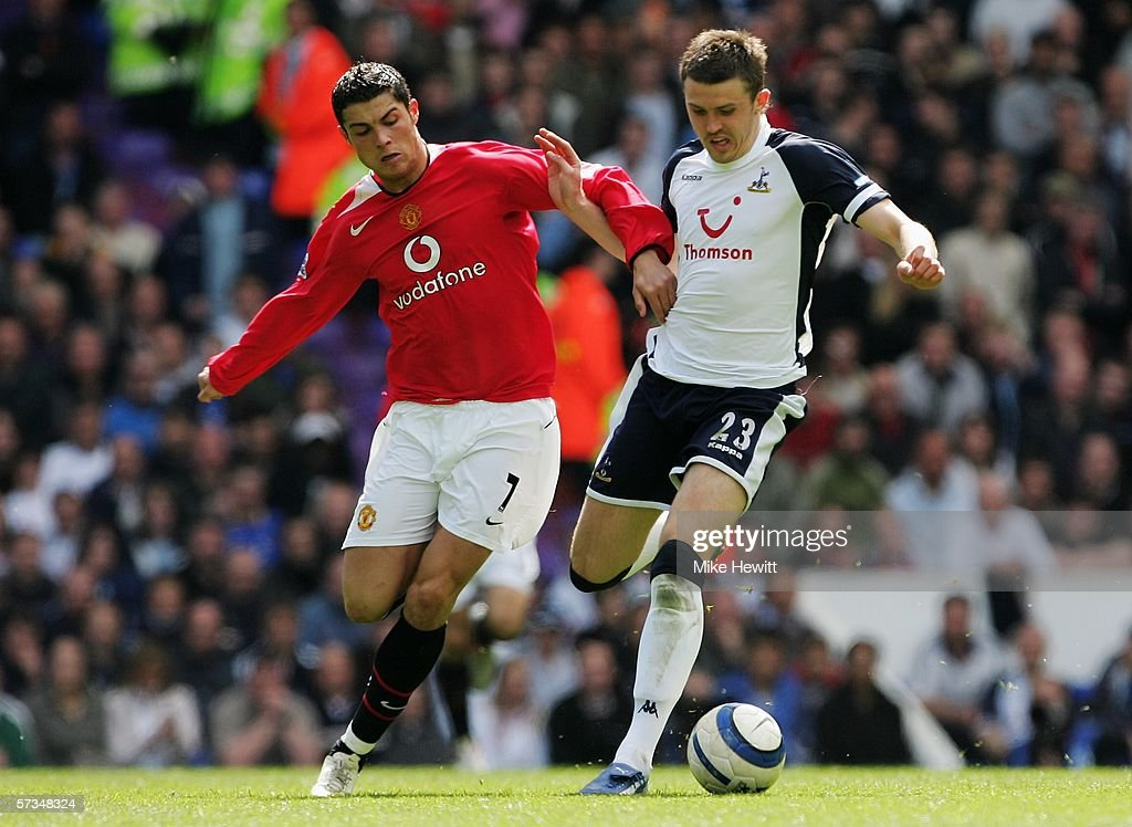 Michael Carrick of Tottenham and Cristiano Ronaldo of Manchester United battle for the ball during the Barclays Premiership match between Tottenham Hotspur and Manchester United at White Hart Lane on April 17, 2006 in London, England.