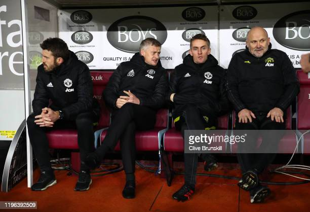 Michael Carrick, Ole Gunnar Solskjaer, Kieran Mckenna and Mike Phelan look on prior to the Premier League match between Burnley FC and Manchester...