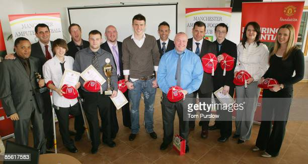 Michael Carrick presents Great Britain Amputee footballers with caps at Carrington Training Ground on March 19 2009 in Manchester England