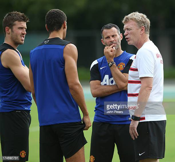 Michael Carrick Rio Ferdinand Ryan Giggs and Manager David Moyes of Manchester United in action during a first team training session as part of their...