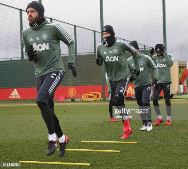Michael Carrick Scott McTominay and Marcus Rashford of Manchester United in action during a first team training session at Aon Training Complex on...