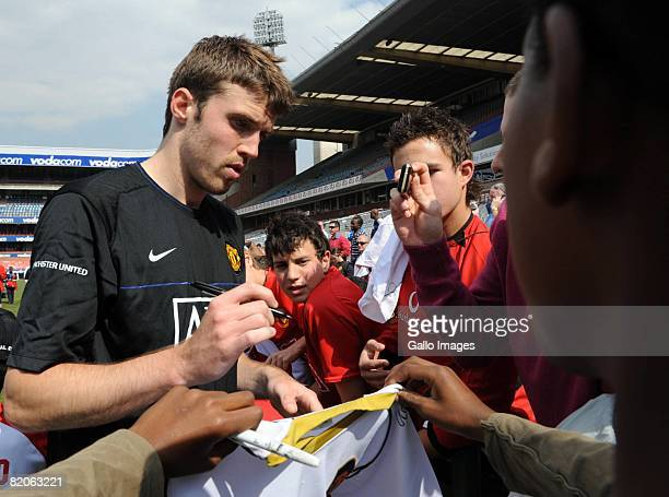 Michael Carrick signs autographs during the Manchester United training session held at Loftus Versfeld Stadium on July 25 2008 in Pretoria South...