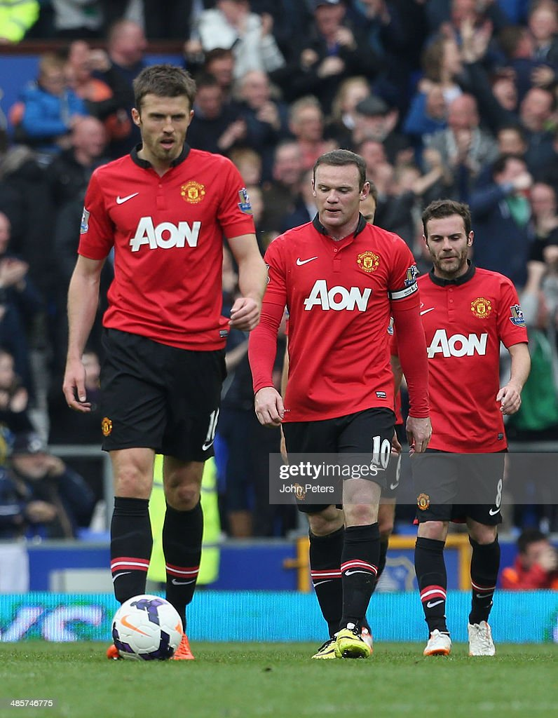 Michael Carrick, Wayne Rooney and Juan Mata of Manchester United show their disappointment during the Barclays Premier League match between Everton and Manchester United at Goodison Park on April 20, 2014 in Liverpool, England.