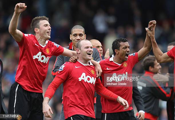 Michael Carrick ,Wayne Rooney ,Chris Smalling and Nani of Manchester United celebrate clinching the title during the Barclays Premier League match...