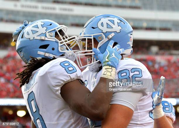 Michael Carter celebrates with Brandon Fritts of the North Carolina Tar Heels after scoring a touchdown against the North Carolina State Wolfpack...