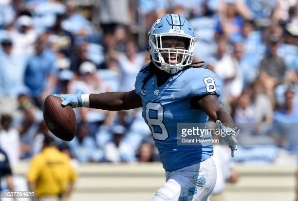 Antonio Williams of the North Carolina Tar Heels breaks through the Pittsburgh Panthers defensive line during their game at Kenan Stadium on...