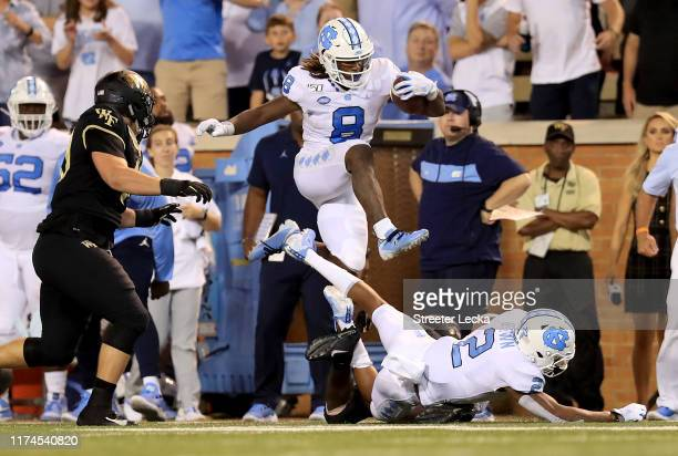 Michael Carter of the North Carolina Tar Heels runs with the ball against the Wake Forest Demon Deacons during their game at BBT Field on September...