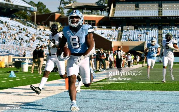 Michael Carter of the North Carolina Tar Heels scores a touchdown against the Wake Forest Demon Deacons during the fourth quarter of their game at...