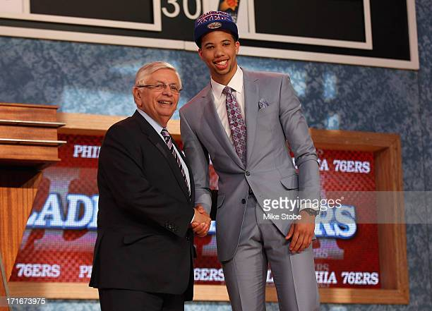 Michael CarterWilliams of Syracuse poses for a photo with NBA Commissioner David Stern after CarterWilliams was drafted overall in the first round by...