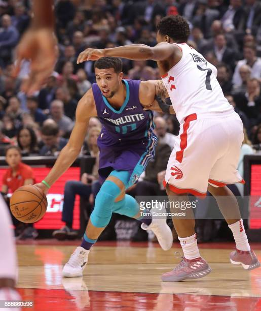 Michael CarterWilliams of the Charlotte Hornets dribbles as he is guarded by Kyle Lowry of the Toronto Raptors during NBA game action at Air Canada...