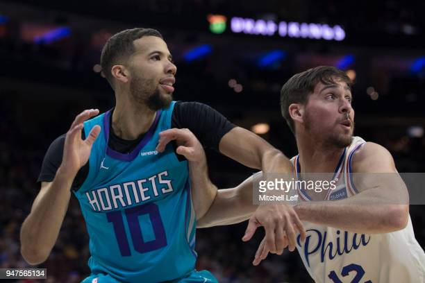 Michael CarterWilliams of the Charlotte Hornets fights for position against TJ McConnell of the Philadelphia 76ers at the Wells Fargo Center on March...