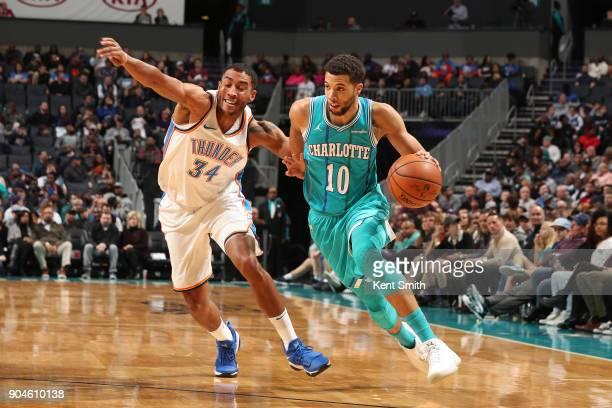 Michael CarterWilliams of the Charlotte Hornets handles the ball against Josh Huestis of the Oklahoma City Thunder on January 13 2018 at Spectrum...