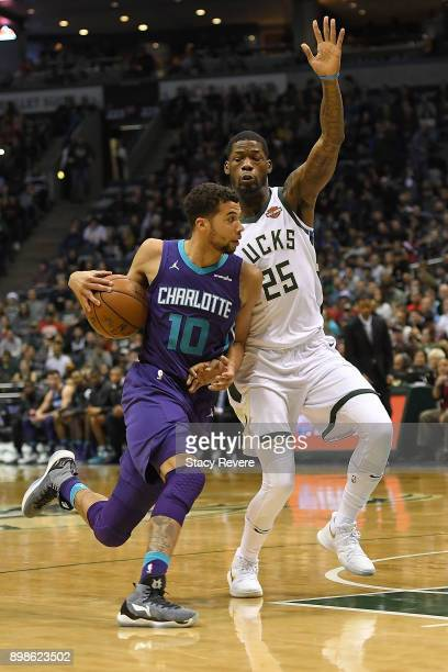 Michael CarterWilliams of the Charlotte Hornets is defended by DeAndre Liggins of the Milwaukee Bucks during a game at the Bradley Center on December...