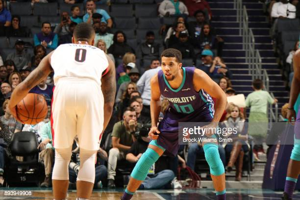 Michael CarterWilliams of the Charlotte Hornets plays defense against the Portland Trail Blazers on December 16 2017 at Spectrum Center in Charlotte...