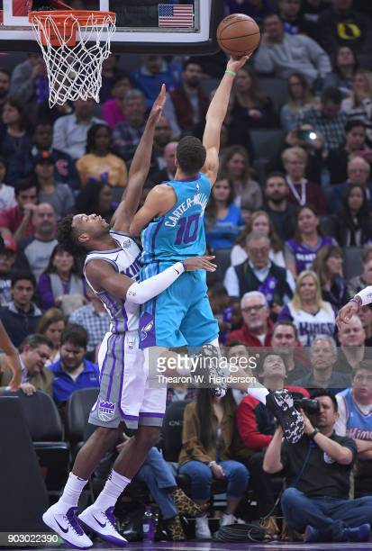 Michael CarterWilliams of the Charlotte Hornets shoots over Buddy Hield of the Sacramento Kings during an NBA basketball game at Golden 1 Center on...