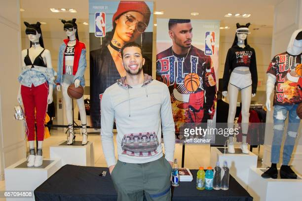 Michael CarterWilliams of the Chicago Bulls meets fans at the Forever 21 x NBA Collection Launch Party on March 23 2017 in Chicago Illinois