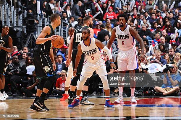 Michael CarterWilliams of the Milwaukee Bucks defends the ball against Chris Paul of the Los Angeles Clippers during the game on December 16 2015 at...