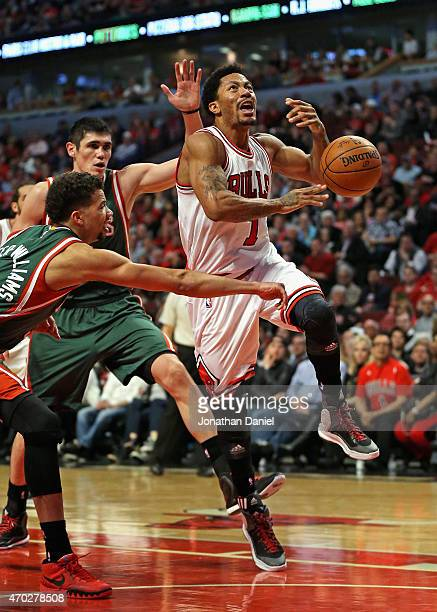 Michael CarterWilliams of the Milwaukee Bucks knocks the ball away from Derrick Rose of the Chicago Bulls after he had driven past Ersan Ilyasova...