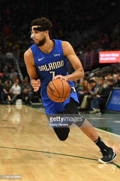 Michael CarterWilliams of the Orlando Magic handles the ball during a game against the Milwaukee Bucks at Fiserv Forum on December 09 2019 in...