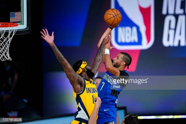 Michael Carter-Williams of the Orlando Magic shoots over JaKarr Sampson Indiana Pacers during the first half of an NBA basketball game on August 4,...