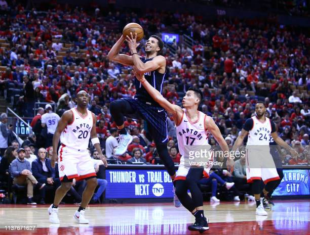 Michael CarterWilliams of the Orlando Magic shoots the ball as Jeremy Lin of the Toronto Raptors defends during Game Two of the first round of the...